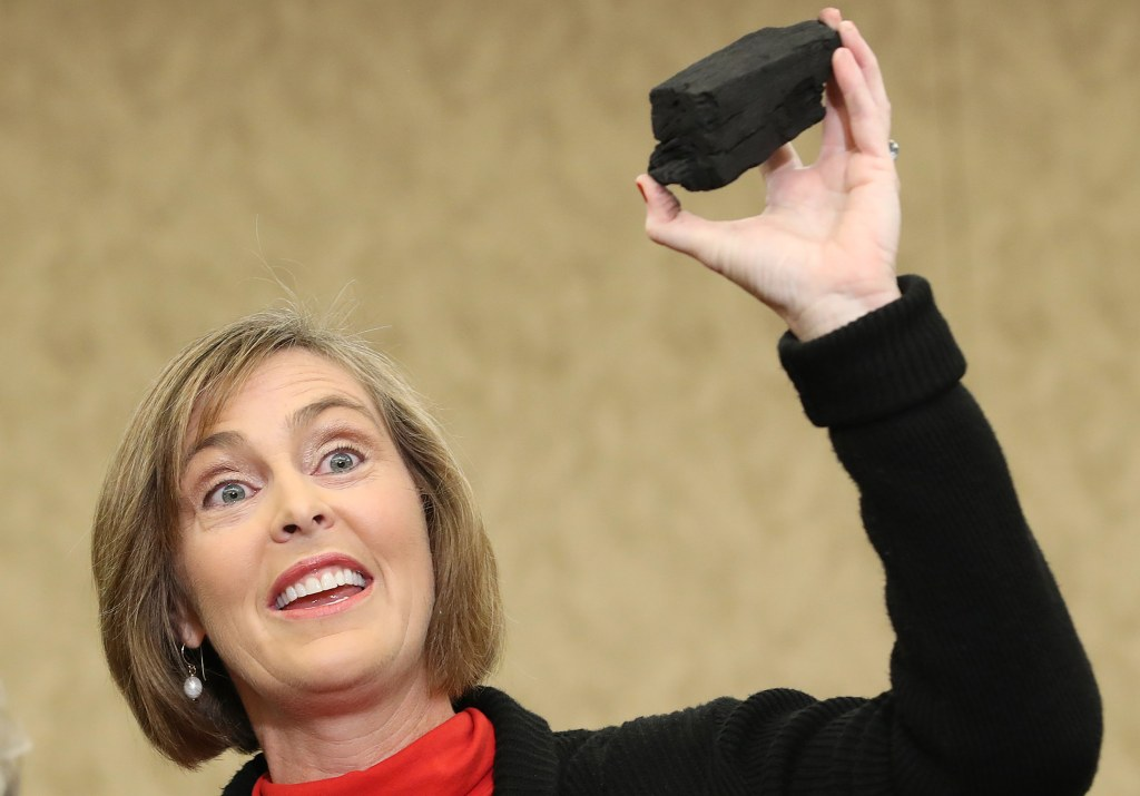 Image: Rep. Kathy Castor holds up a symbolic piece of coal