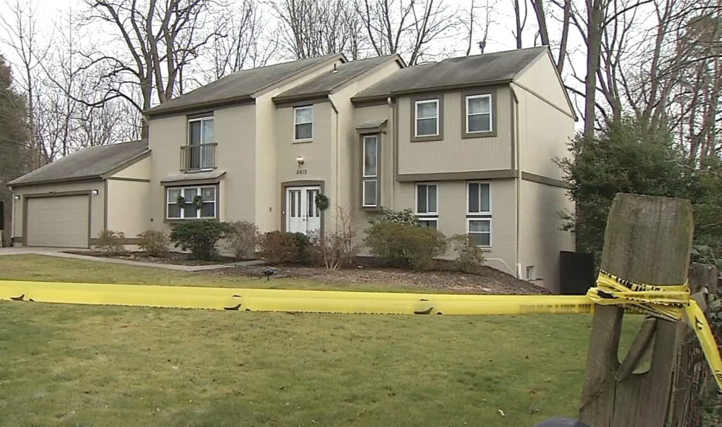 Image: Image: Crime scene tape outside the home of Scott Fricker and his wife Buckley Kuhn-Fricker in Reston Virginia