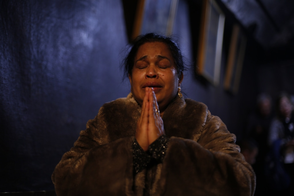 Image: A worshipper prays inside the Church of the Nativity