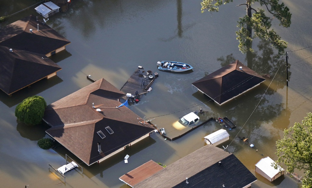 Image: A boat sits near flooded homes in the aftermath of Tropical Storm Harvey in Beaumont, Texas