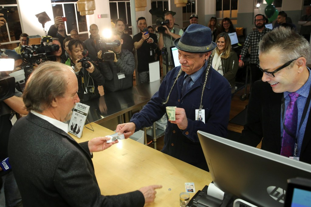 Image: Steve DeAngelo makes the first legal recreational marijuana sale to Henry Wykowski at Harborside in Oakland