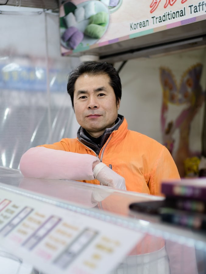 Image: South Korean candy vendor Go Young Ho, 50, hopes for a thaw in relations between North Korea, South Korea and the United States during the 2018 Winter Olympics.