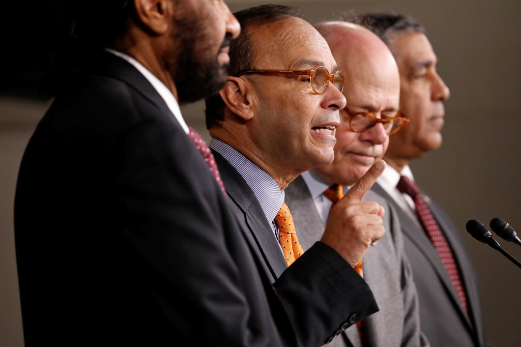 Image: Rep. Luis Gutierrez (D-IL), accompanied by Rep. Al Green (D-TX), Rep. Steve Cohen (D-TN) and Rep. Adriano Espaillat (D-NY), speaks at a press conference announcing articles of impeachment being filed against President Donald Trump on Capitol Hill i