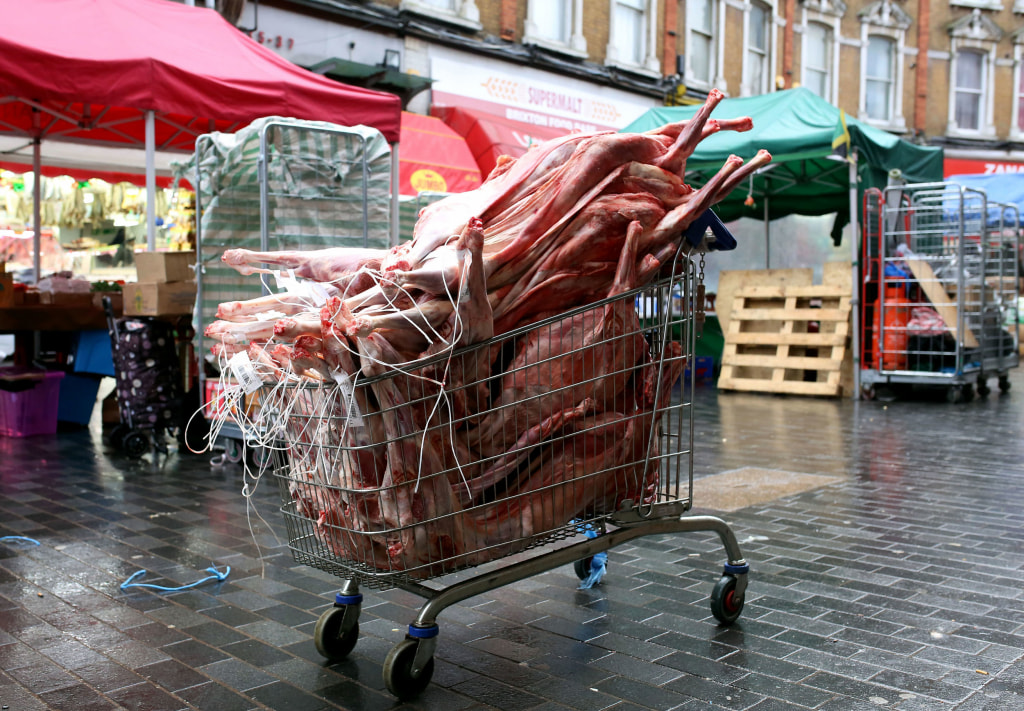 Image: Raw meat sits piled in a shopping cart on Electric Avenue in Brixton