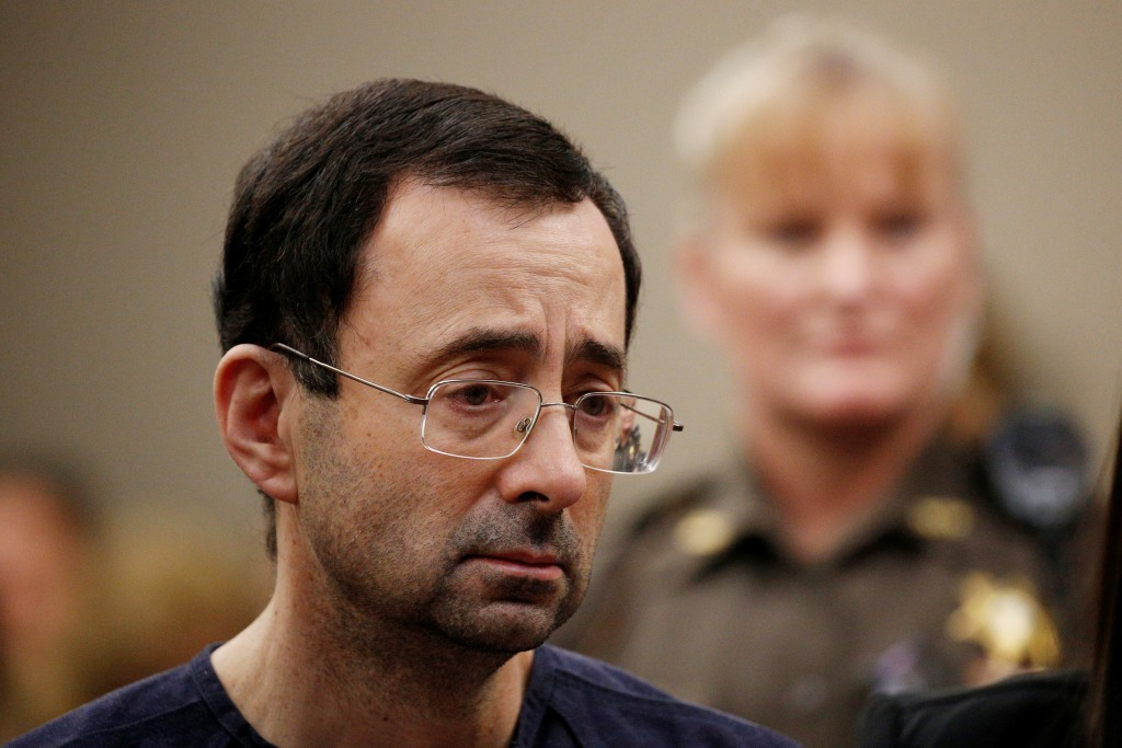 Image: Larry Nassar stands with his legal team during his sentencing hearing