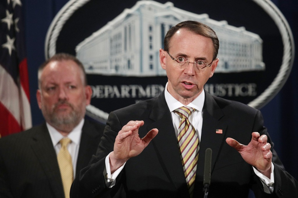 Image: Deputy U.S. Attorney General Rod Rosenstein speaks as Acting DEA Administrator Robert Patterson listens during a news conference