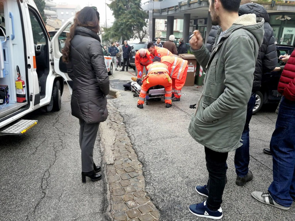Image: Healthcare personnel take care of an injured person after being shot by gun fire from a vehicle, in Macerata, Italy, on Feb. 3, 2018.