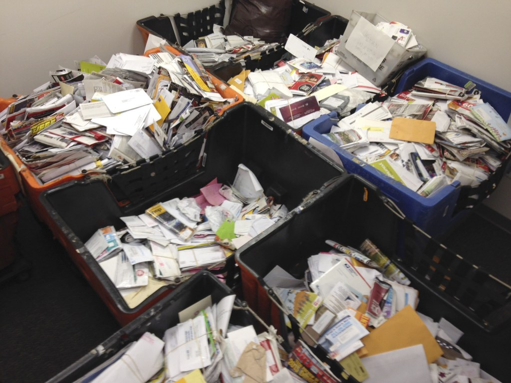 Image: Undated handout picture of mail that a New York City mailman allegedly stashed away in his home and car