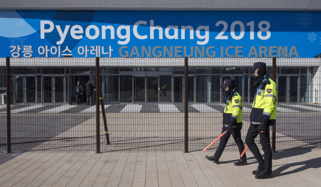Image: Police officers walk the perimeter of the Gangneung Ice Arena