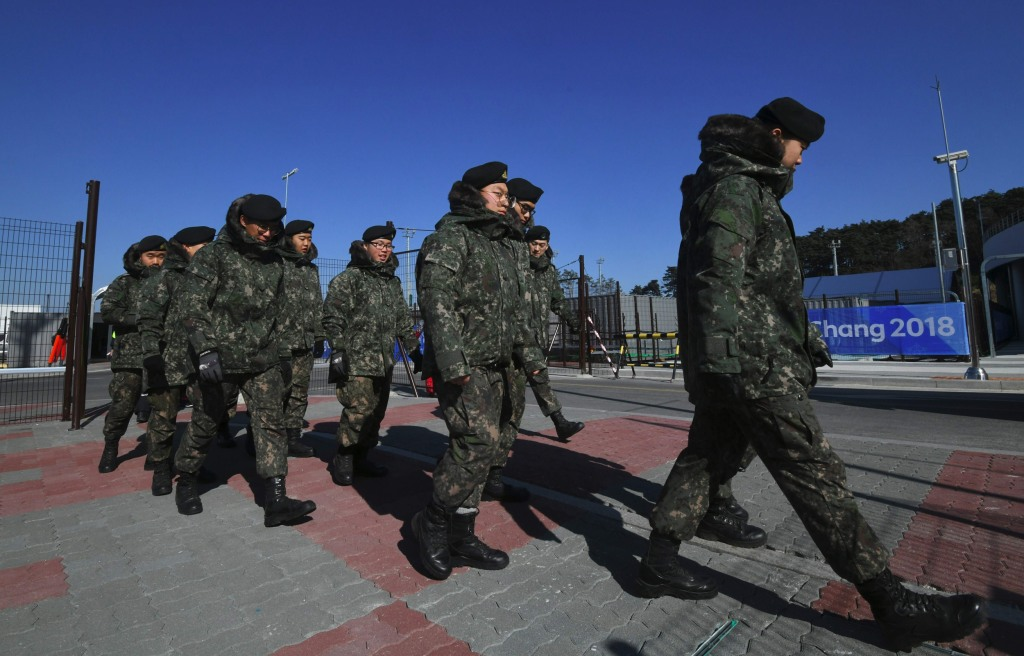 Image: South Korean soldiers move at a security checkpoint