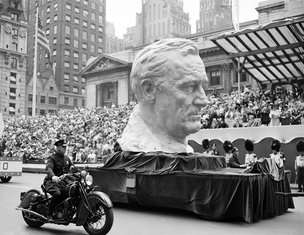 Image: A float carrying a bust of President Franklin Roosevelt rolls up Fifth Avenue during a war parade