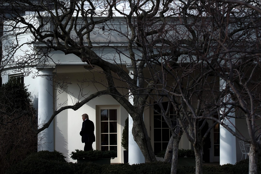 Image: Image: President Donald Trump walks to Marine One for his first trip as President, on the South Lawn of the White House January 26, 2017