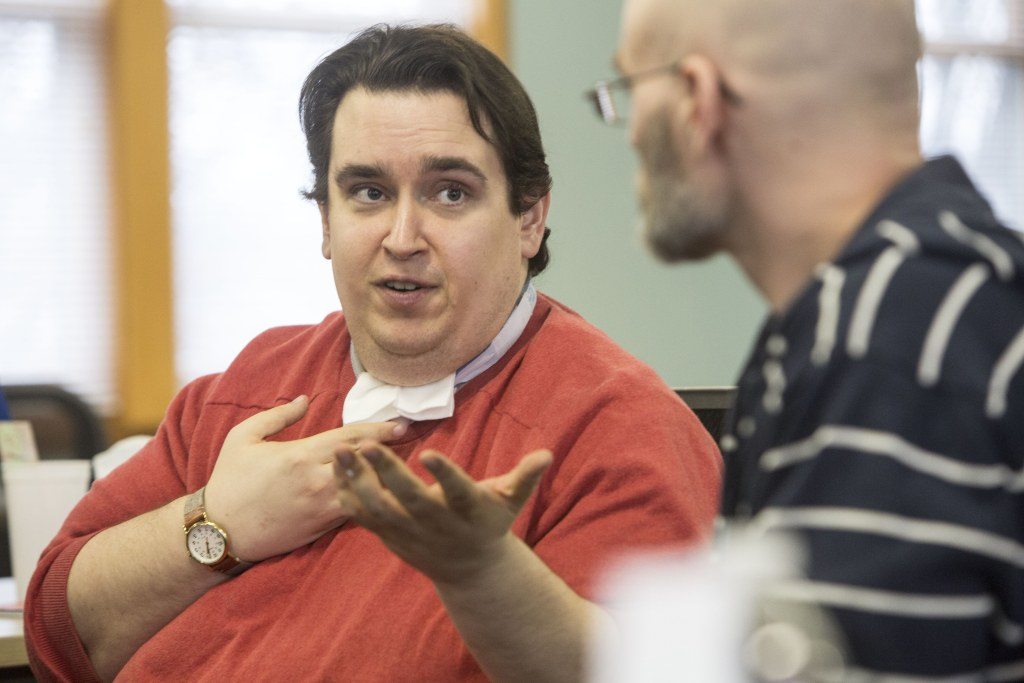 Image: Cody Williamson speaks to Brandon Banks, peer support specialist at Bridgehaven Mental Health Services in Louisville, Ky.