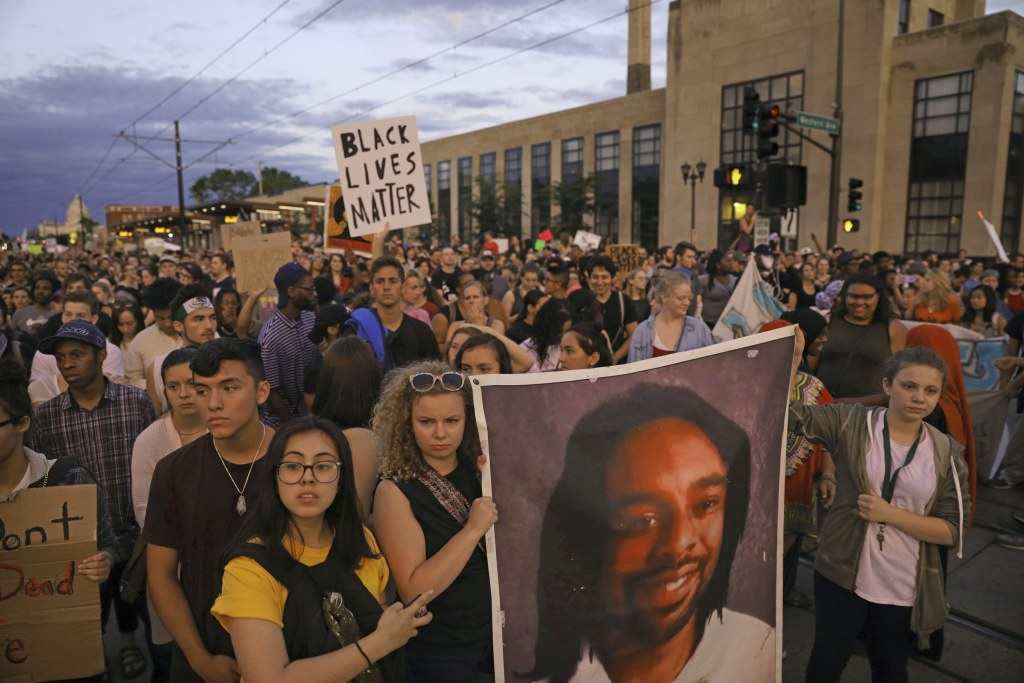 Image: Supporters of Philando Castile hold a portrait of Castile as they march along University Avenue in St. Paul, Minnesota, leaving a vigil at the state Capitol on June 16, 2017.