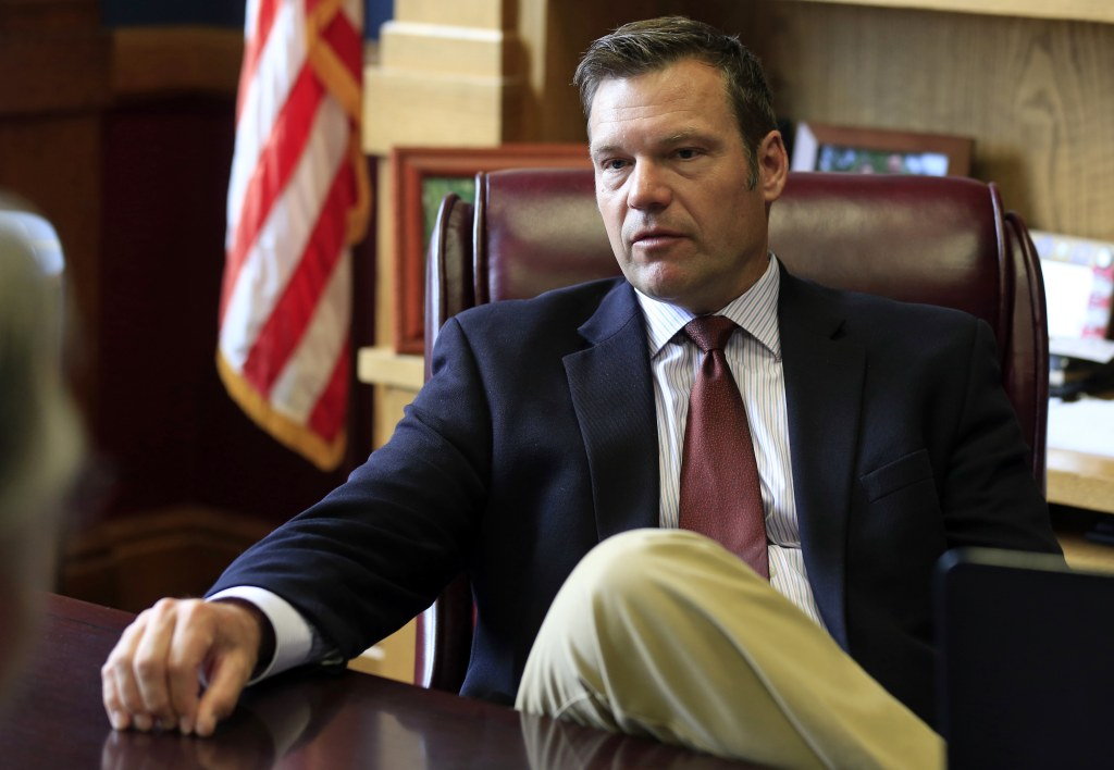 Kansas Secretary of State Kris Kobach talks with a reporter in his office in Topeka on May 17. Orlin Wagner / AP file