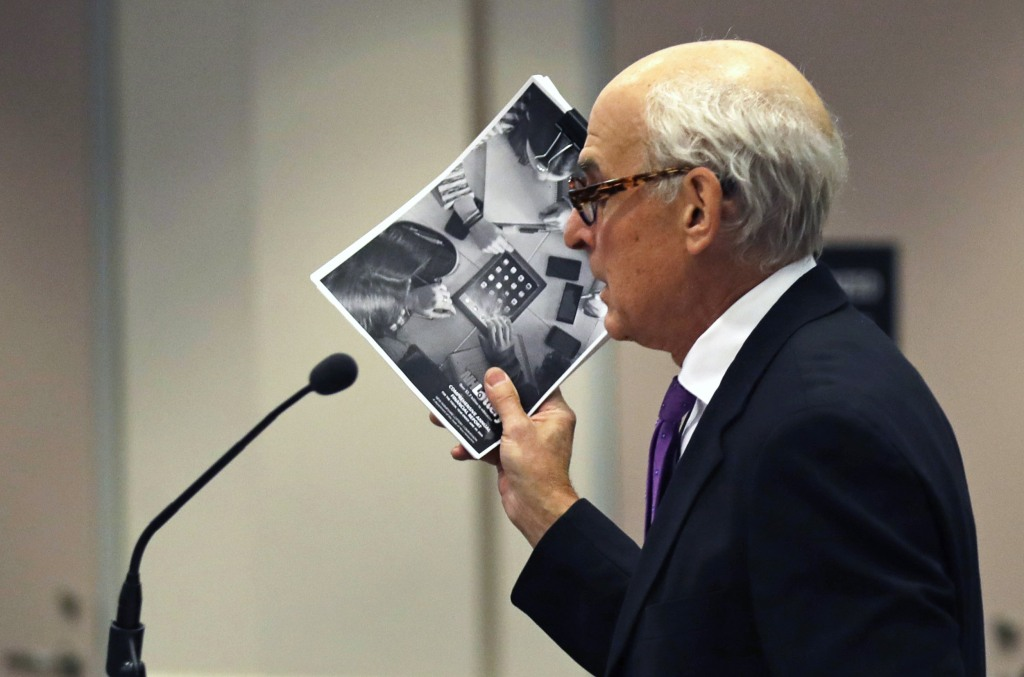 "Image: Attorney Steven M. Gordon, who represents lottery winner ""Jane Doe"" holds up an annual report"
