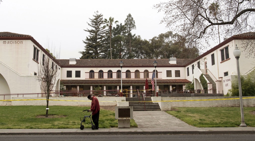 Image: A man passes the Veterans Home of California the morning after a hostage situation in Yountville, California, on March 10, 2018.