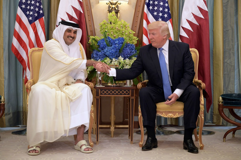 Image: President Donald Trump and Qatar's Emir Sheikh Tamim Bin Hamad Al-Thani take part in a bilateral meeting at a hotel in Riyadh on May 21, 2017.