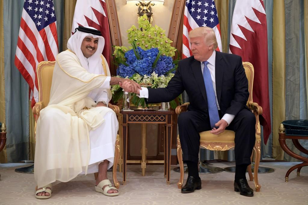 Image: President Donald Trump and Qatar's Emir Sheikh Tamim Bin Hamad Al-Thani take part in a bilateral meeting at a hotel in Riyadh on May 21, 2017.