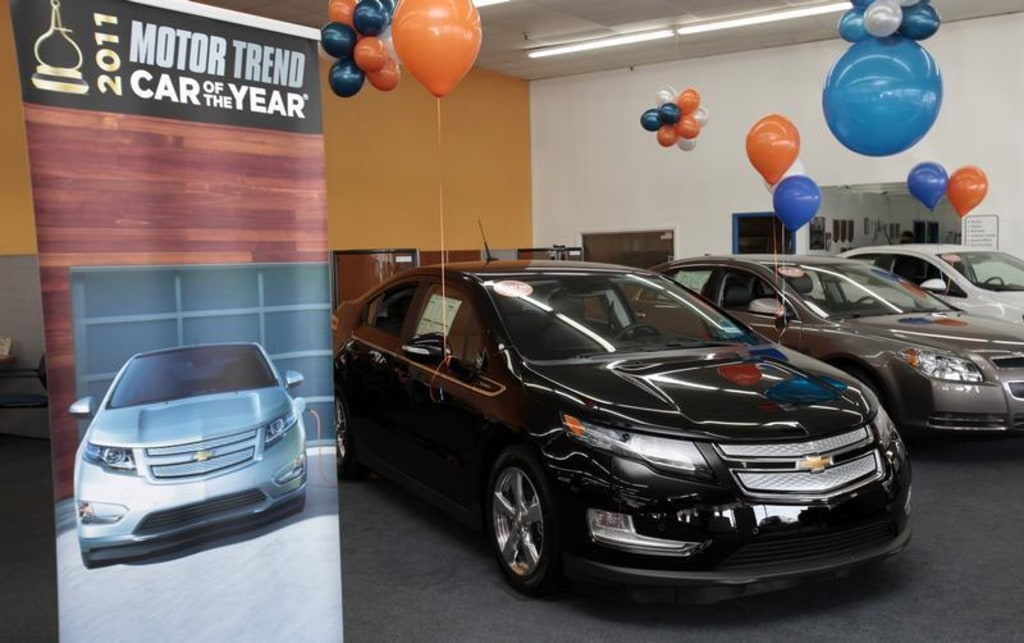 A Black 2017 Chevrolet Volt Electric Car Is Seen On Display In The Showroom Of George