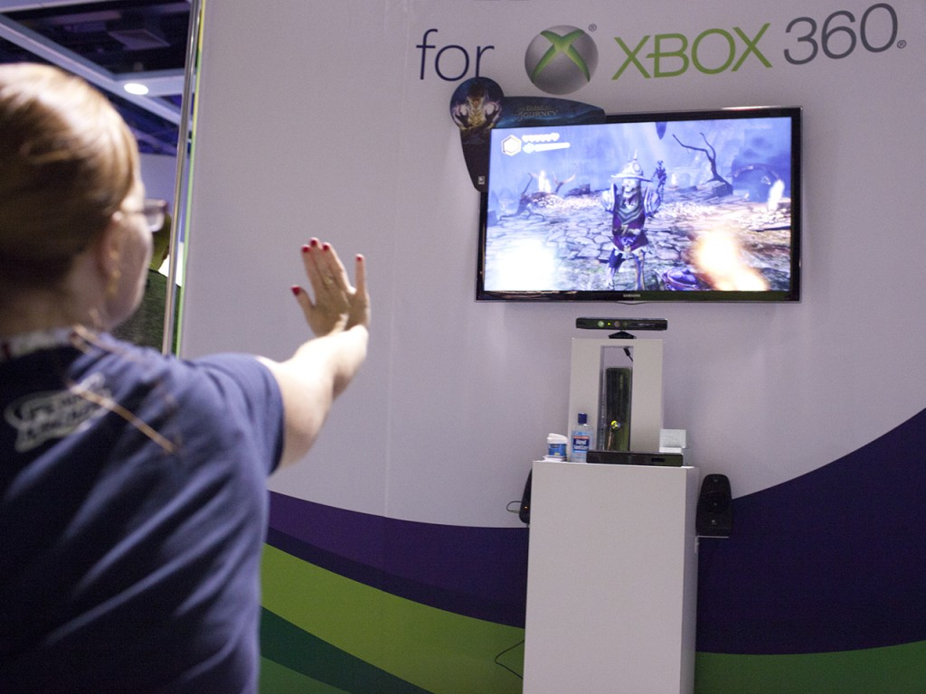 Monica Rysavy plays Fable with gestures from her hand toward the X-Box 360 Kinect console during Seattle's PAX Convention, Aug. 31, 2012. Kyle Bruggem...