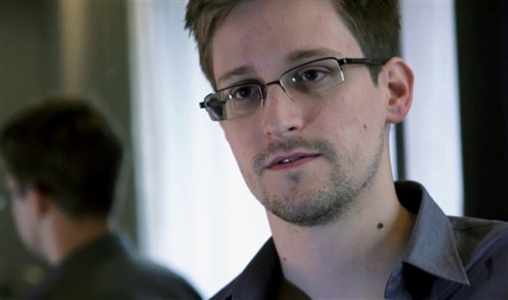 FILE - A Sunday, June 9, 2013, file photo provided by The Guardian newspaper in London shows Edward Snowden, who worked as a contract employee at the ...