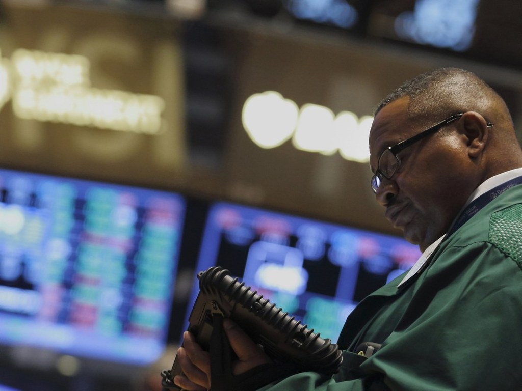 Wall Street remains a hard place for blacks to get ahead. Here, a trader works on the floor of the New York Stock Exchange on Monday.