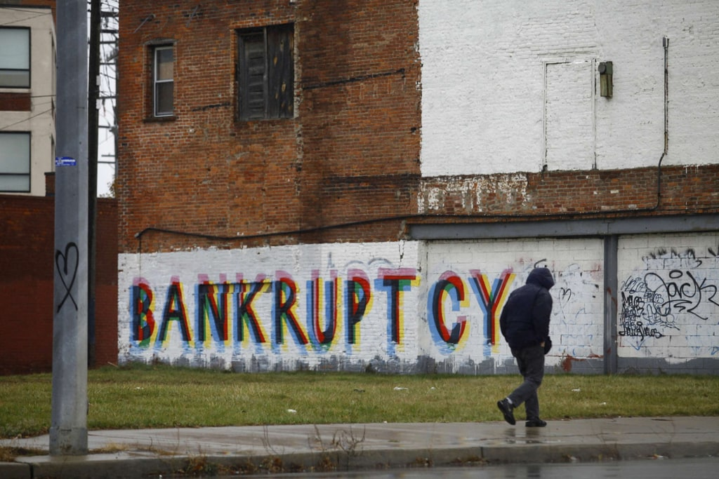 Detroit is eligible to proceed with the largest municipal bankruptcy in U.S. history, a judge ruled Tuesday. Who will pick up the tab?