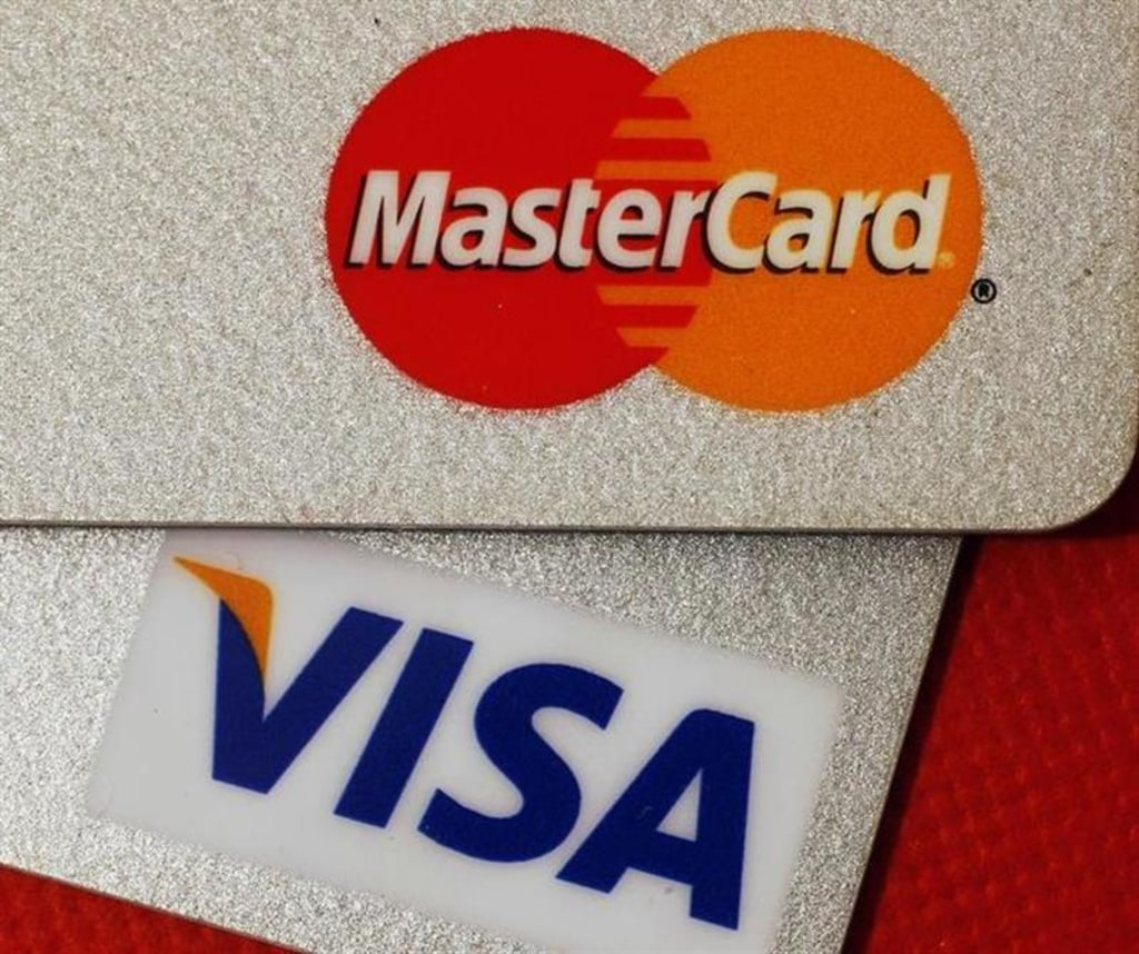 a judge approved a class action settlement between merchants and mastercard and visa over transaction - Credit Card Fees For Businesses