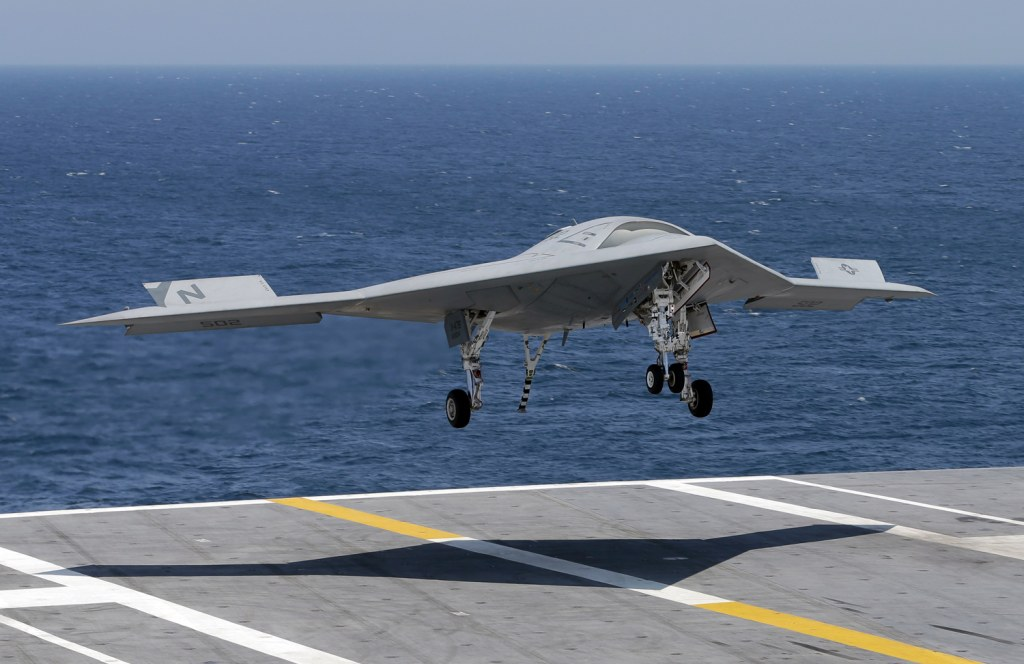 A X47-B Navy drone approaches the deck as it lands aboard the nuclear aircraft carrier USS George H. W. Bush off the Coast of Virginia Wednesday, July...