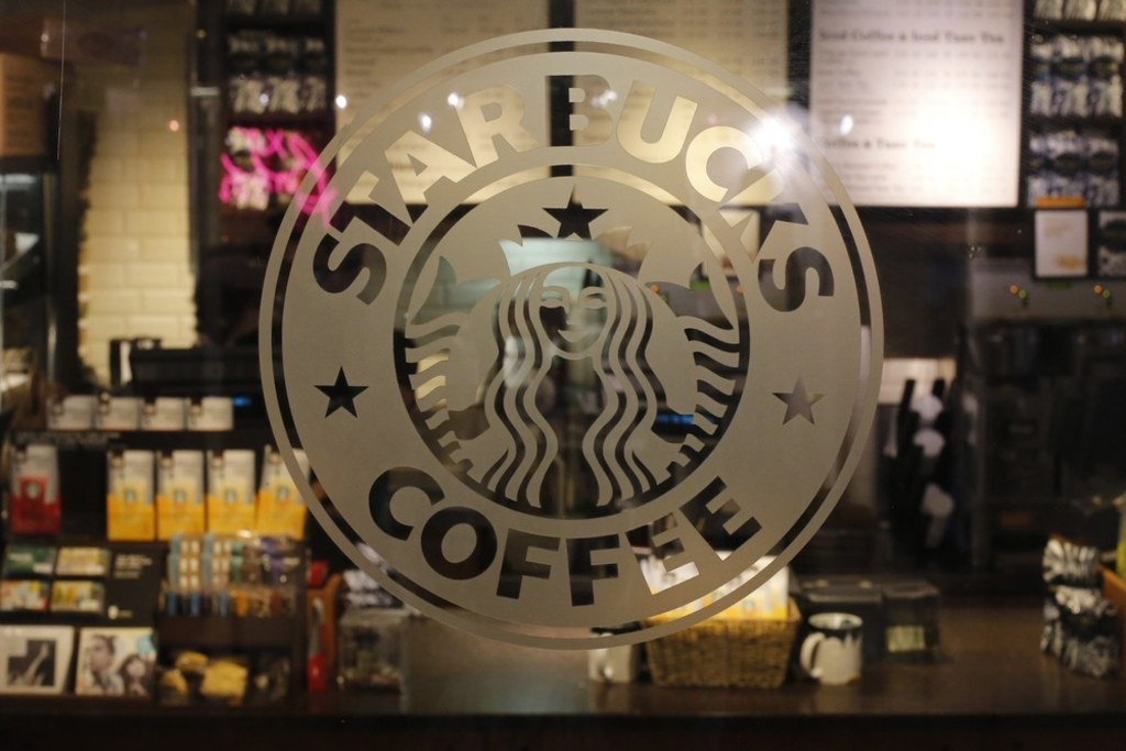 The logo of a Starbucks coffee shop is seen in New York June 25, 2013.