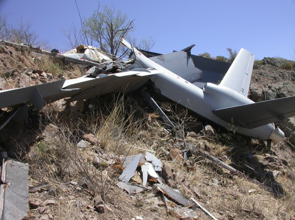 """The remains of a Predator B, """"Reaper"""" drone, sprinkled across the Arizona mountainside."""