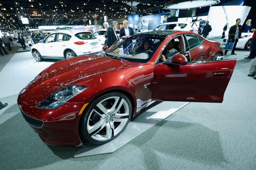 Reporters Gather Around A Fisker Karma During The Los Angeles Auto Show On November 29