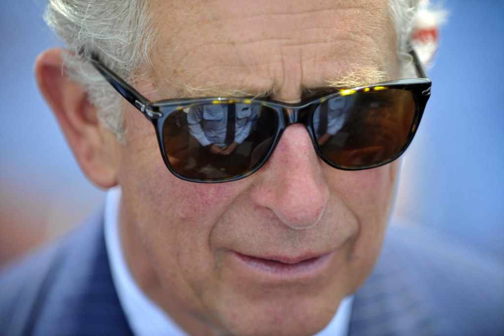 Prince Charles, who turns 65 Thursday, is marking the event by criticizing Britain's supermarkets for squeezing farmers' incomes.