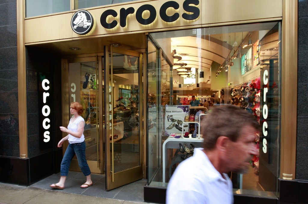 CHICAGO - JULY 23:  A shopper leaves a Crocs retail store on State Street July 23, 2009 in Chicago, Illinois.  The struggling shoe manufacturer went p...