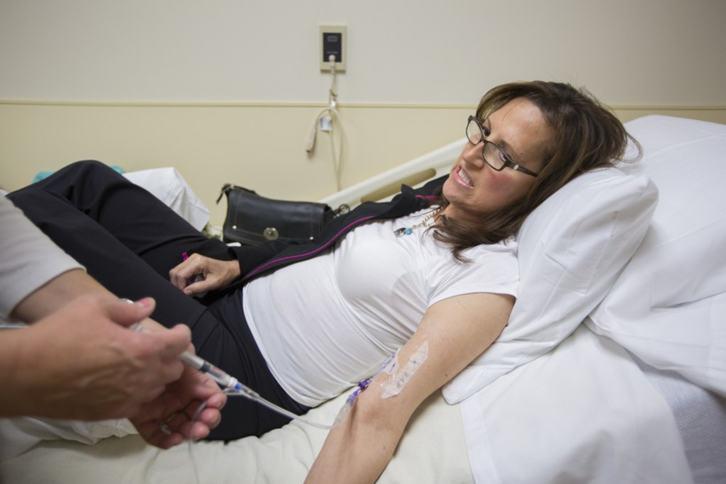 Margaret Snopkowski, 52, of Fowlerville, MI, receives her once-a-week treatment at St. Joseph Mercy Brighton Health Center, in Brighton, MI, on Monday...