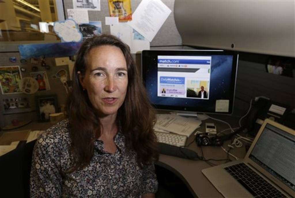 Lynn Boyden, an information architect in web services at the University of Southern California, poses with a dating website on her computer at the USC...