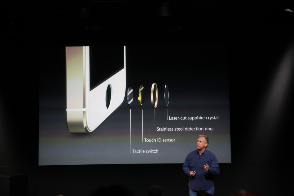Apple's Phil Schiller shows off the innards of the Touch ID system on the iPhone 5S.