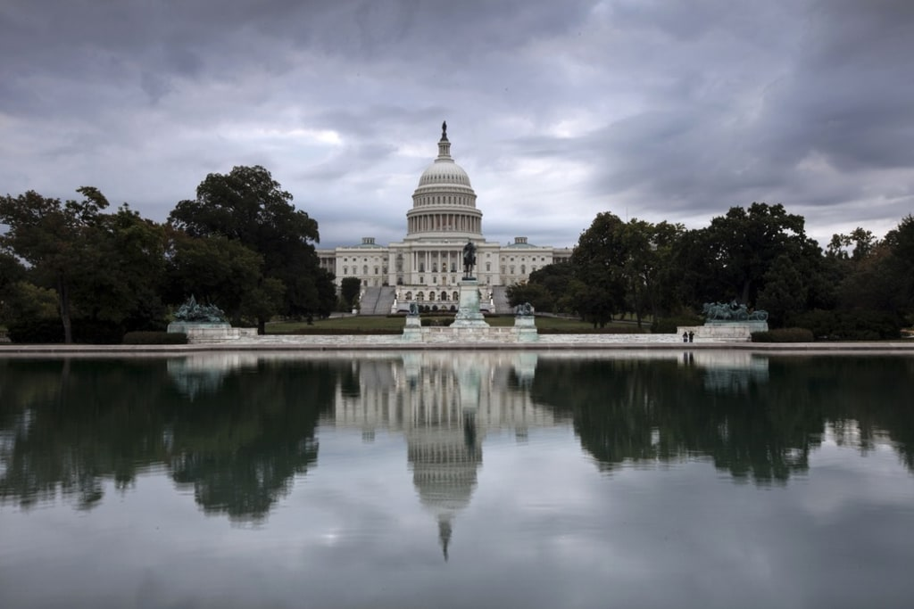 Storm clouds hang over Capitol Hill in Washington, Friday, Sept. 27, 2013, as the Republican-controlled House and the Democrat-controlled Senate stand...