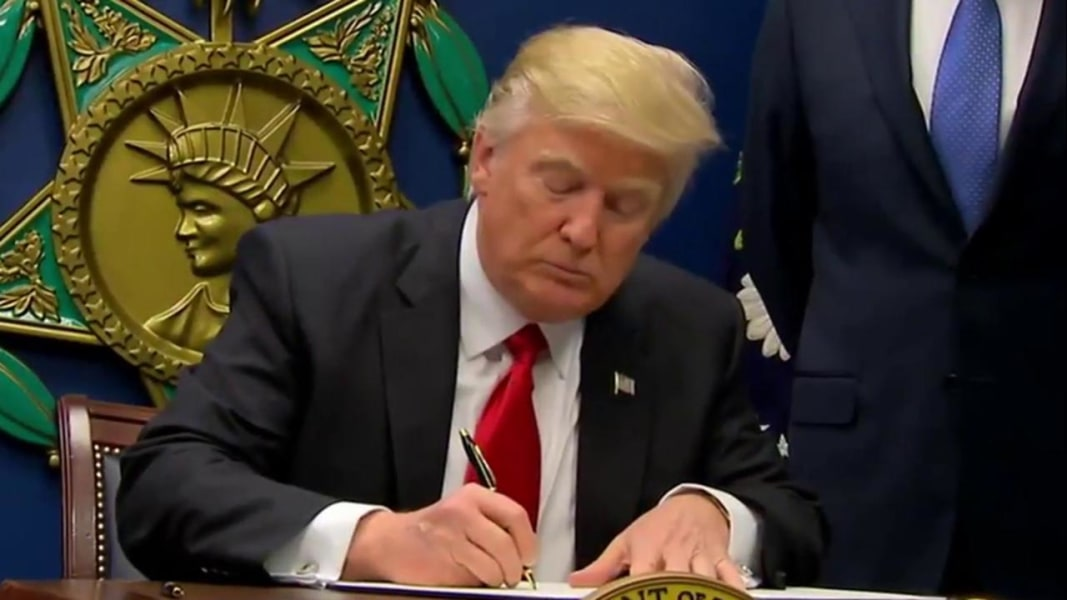Image result for donald trump signs executive order
