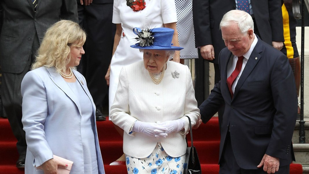 Governor General breaks royal protocol by touching Queen