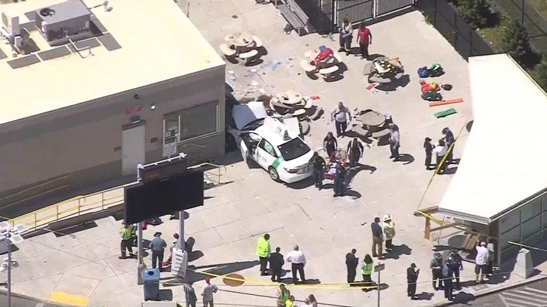 Taxi jumps curb near Boston airport, injures pedestrians
