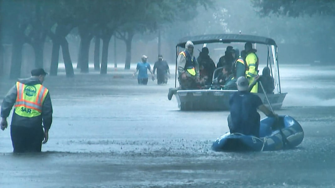 Van swept away with 6 relatives in Harvey's flood found