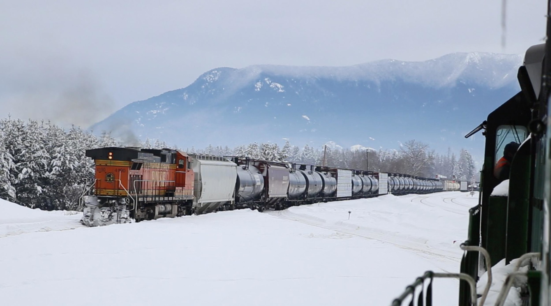 What is the difference between a through freight train and a local freight train?