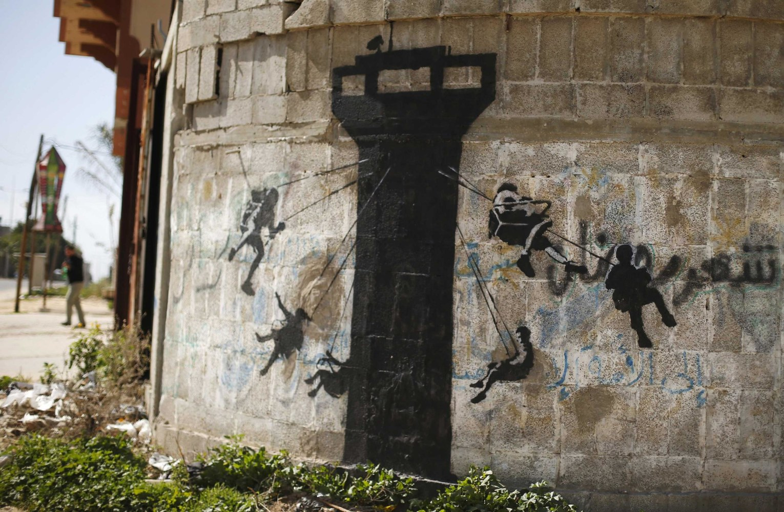 Internet cats banksy kitten highlights gaza 39 s plight for Banksy mural painted over