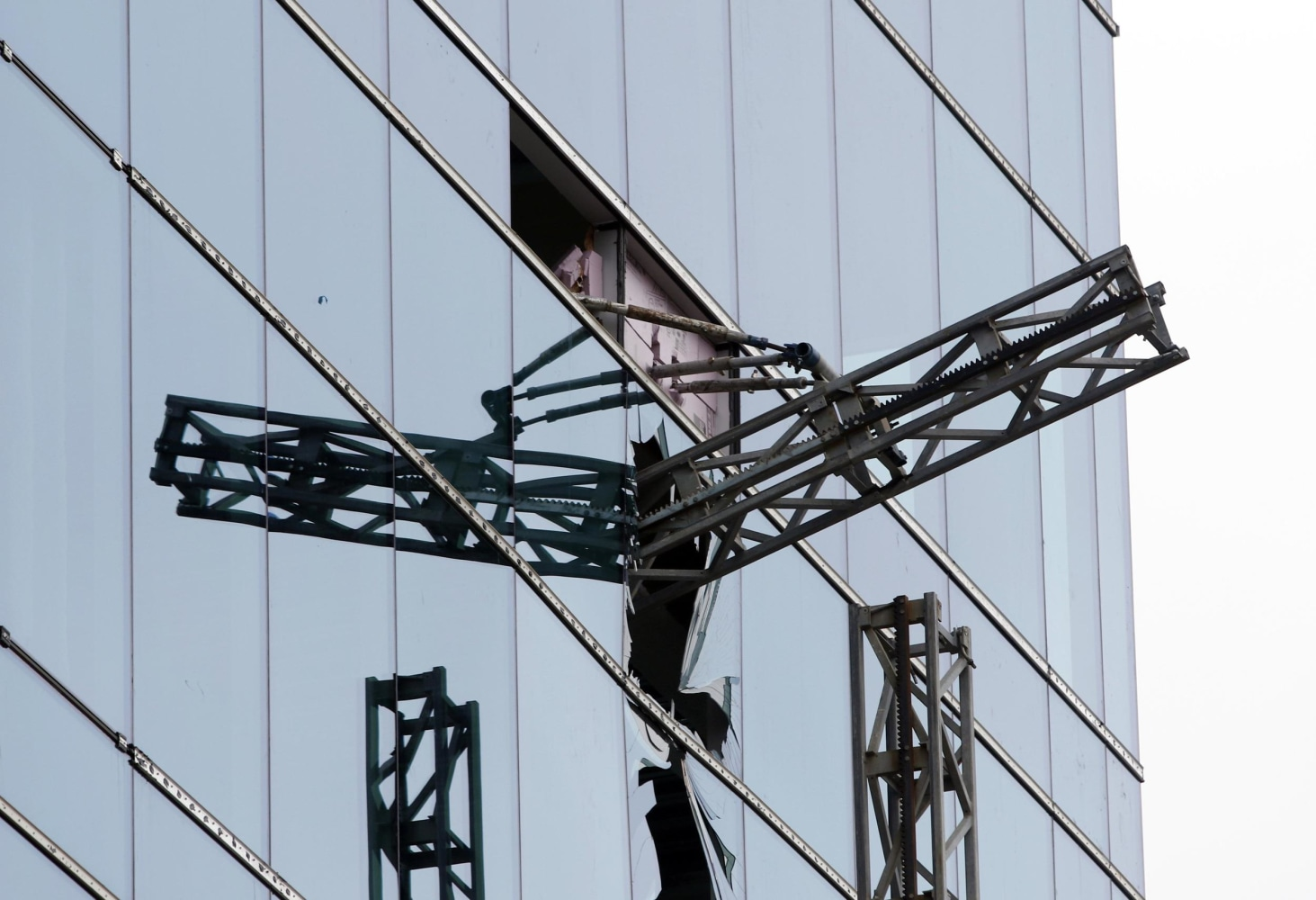 three killed one in serious condition after north carolina a section of scaffolding protrudes from a shattered window at the scene of a construction accident that killed three people and sent another to a hospital