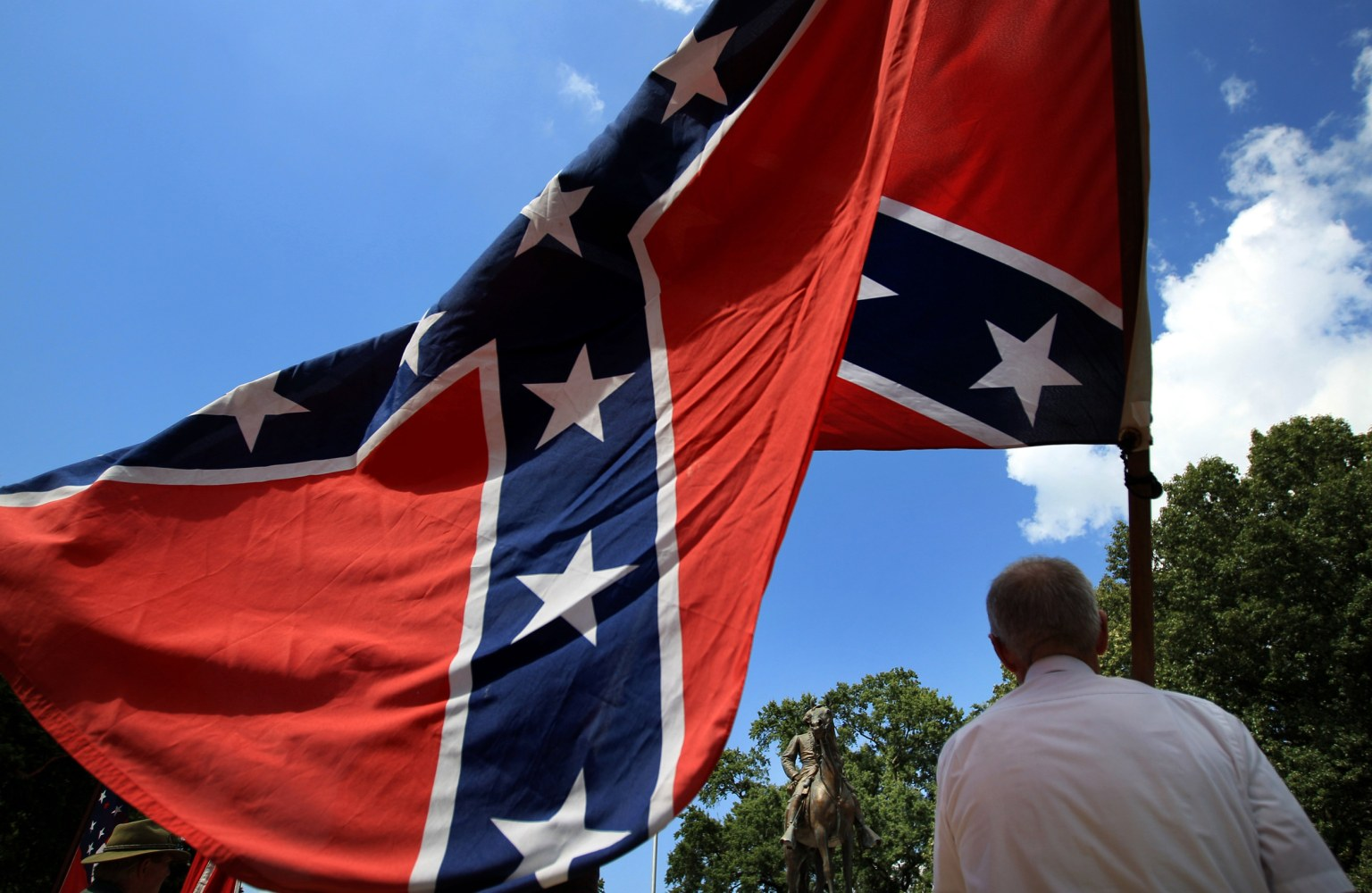 Confederate flag rally tests a diminished ku klux klan nbc news image eddie miller holds a confederate flag in front of the statue and tomb of biocorpaavc