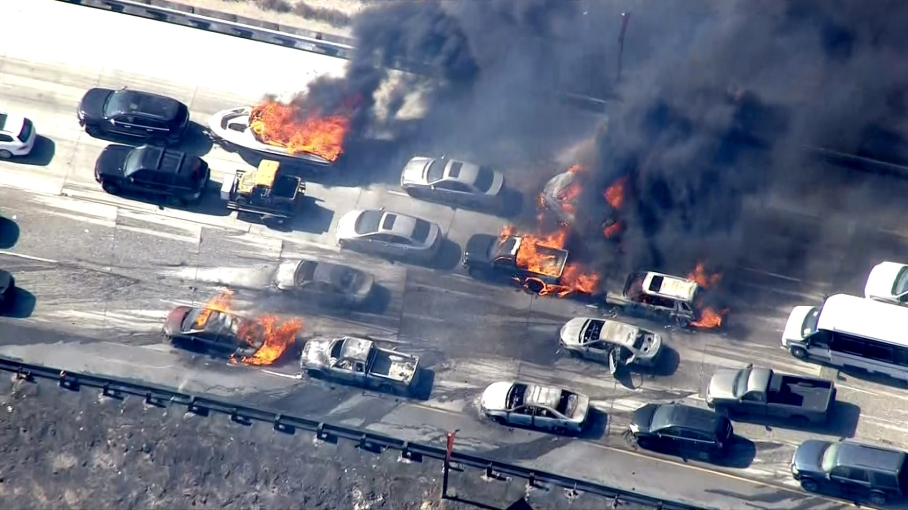 Cars in flames on Interstate 15 after winds drove a wildfire over the ...