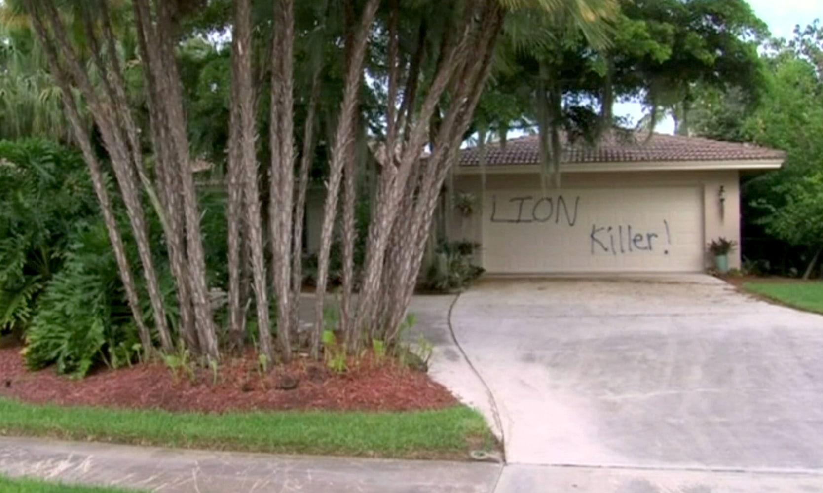 Home of lion hunter walter palmer dentist who killed cecil image graffiti covers the garage door of the holiday home of dentist walter palmer on rubansaba