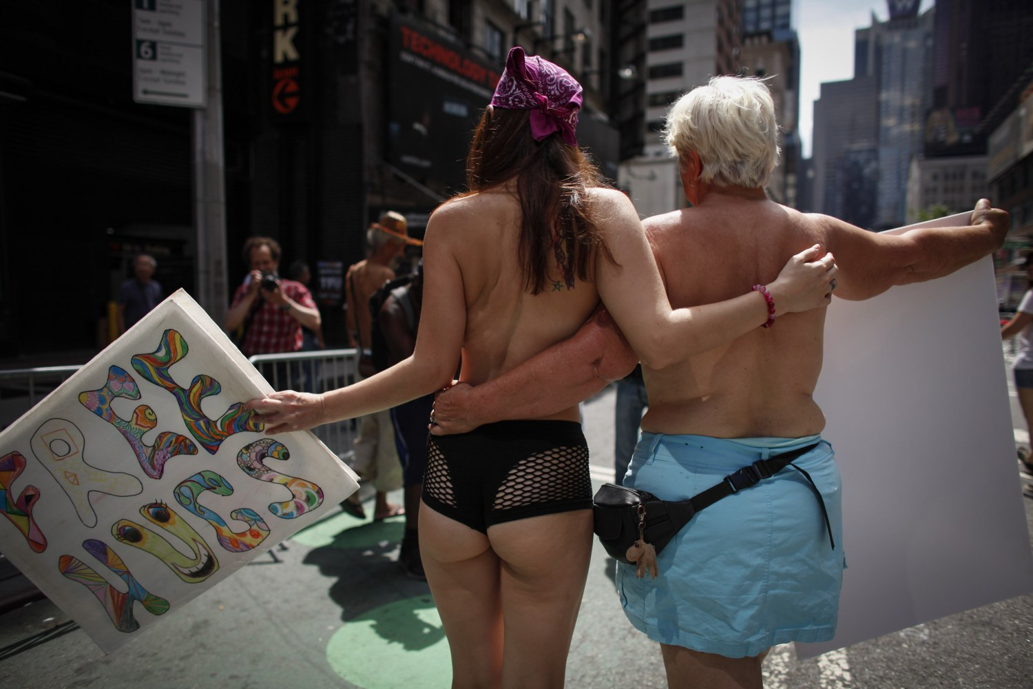 women topless in front of man